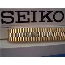 Seiko Watch Band Back Plate# 7N43-8A89 18mm gold tone Stretch Band w/Curved End
