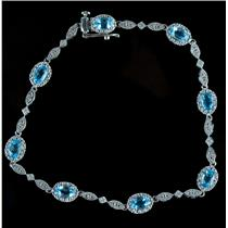 10k White Gold Oval Cut Blue Topaz & Diamond Halo Style Bracelet 4.06ctw
