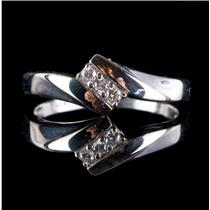 10k White Gold Round Cut Diamond Three Stone Ring .06ctw 1.33g