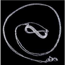 10k White Gold Single Round Cut Diamond Infinity Style Necklace .085ctw