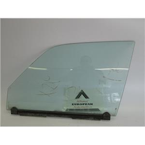 Jaguar XJ6 left front door glass 80-87