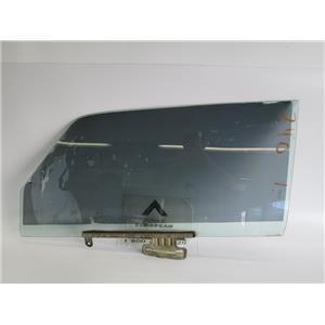 Volvo 240 left front window glass 1213062