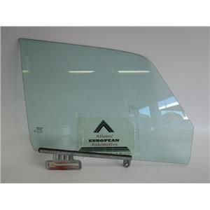 Volvo 240 right front window glass 1213059