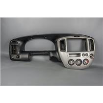 2006 Mazda Tribute Dash Trim Bezel w/ Vents, 12v outlet & Rear Defrost Switch