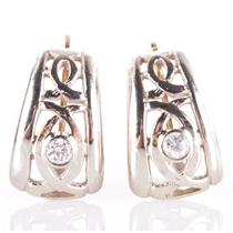 10k Yellow & White Gold Two-Tone Round Cut Cubic Zirconia Huggie Earrings .07ctw