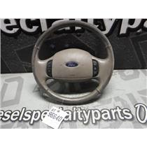 2003 - 2004 FORD F250 F350 LARIAT ( TAN ) STEERING WHEEL -  FAIR CONDITION OEM