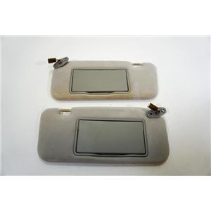 2003 2004 Mitsubishi Diamante Sun Visor Set Pair Covered Lighted Mirrors